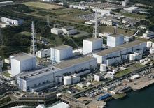 <p>Атомная электростанция Фукусима Дайити, 11 марта 2011 года. Япония сообщила в пятницу об отказе системы охлаждения на атомной электростанции Фукусима Дайити, принадлежащей Tokyo Electric Power, из-за землетрясения. REUTERS/KYODO/Files</p>