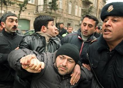 Police detain an opposition activist in Baku March 11, 2011. REUTERS/Abbas Atilay