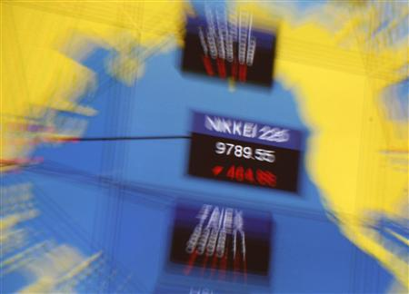 A screen displays Japan's Nikkei index during morning trading at the Hong Kong Stock Exchange March 14, 2011. REUTERS/Bobby Yip