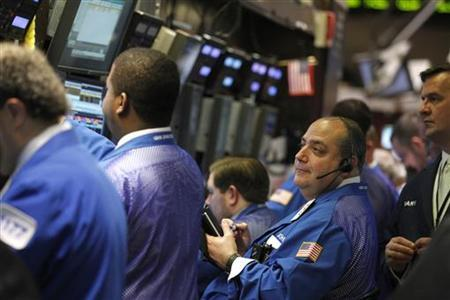 Traders work on the floor at the New York Stock Exchange, March 10, 2011. REUTERS/Brendan McDermid