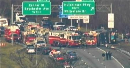 A general view of a bus crash is seen on Interstate 95 in New York in this still image taken from video March 12, 2011. REUTERS/Courtesy of WNBC-TV/Handout