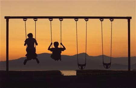 People cool off after sunset on Kitsilano Beach in Vancouver, July 27. REUTERS/ Mike Blake