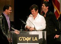 <p>Three members of the Australian band INXS (L-R) Kirk Pengilly, Tim Farriss and J. D. Fortune accept the Excellence in Entertainment Award they received at the Penfolds Icon Gala Dinner during G' Day LA Australia Week 2006 in Hollywood January 14, 2006. REUTERS/Fred Prouser</p>