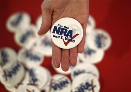 National Rifle Association pins are displayed at a stand at the Conservative Political Action conference in Washington February 10, 2011. REUTERS/Kevin Lamarque