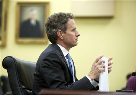 Timothy F. Geithner, Secretary of the Treasury, holds papers before testifying to the Financial Services and General Government Subcommittee on Capitol Hill in Washington on March 16, 2011. REUTERS/Joshua Roberts