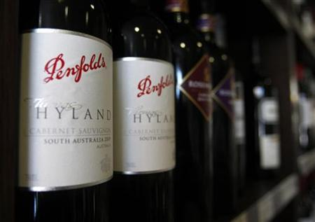 Red wine made by Fosters is displayed on the shelf of a liquor store in Melbourne February 15, 2011. REUTERS/Mick Tsikas