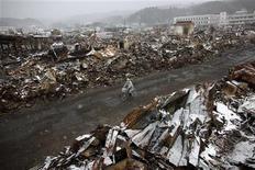 <p>Город Ямада в префектуре Иватэ 17 марта 2011 года. Мощнейшее землетрясение произошло на северо- востоке Японии в прошлую пятницу, вызвав цунами. В результате удара стихии погибли тысячи человек, толчки повредили ряд атомных электростанций. Власти страны отчаянно пытаются не допустить ядерной катастрофы. REUTERS/Aly Song</p>