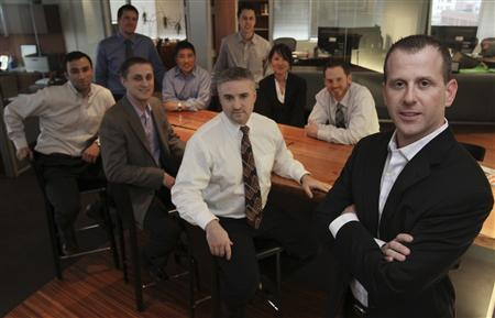 Benchmark Plus director of research Neil Chelo (R) is pictured with employees in his company's offices in Tacoma, Washington, March 1, 2011. An investment analyst, Chelo's job is to be able to tell good hedge fund managers from not-so-good ones. Pictured with Chelo, are Benchmark employees (L-R) John Canorro, Jonathan Christian, Steven Carroll, Judd Lee, Chris Carsley, Jon Erickson, Tashi Schmidt, and Jeremy Gollehon. REUTERS/Anthony Bolante