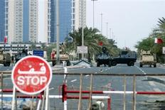 <p>Armoured vehicles belonging to Gulf Cooperation Council (GCC) military forces guard the entrance to Pearl Square in Manama March 17, 2011. REUTERS/James Lawler Duggan</p>