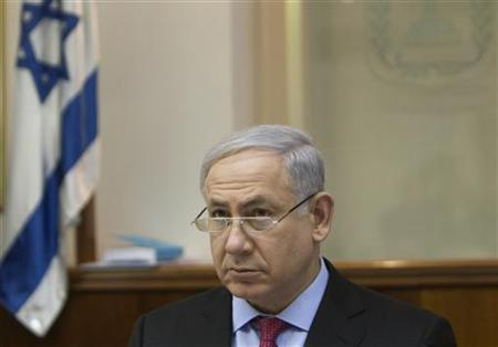 Israel's Prime Minister Benjamin Netanyahu attends the weekly cabinet meeting in Jerusalem March 13, 2011. REUTERS/Ronen Zvulun