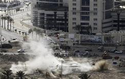 <p>The Pearl Square statue is tore down in Manama March 18, 2011. REUTERS/Hamad I Mohammed</p>