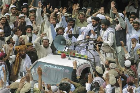 Pakistani tribesmen shout slogans during a protest to condemn U.S. drone attack in Miranshah, located in Pakistan's North Waziristan tribal region March 18, 2011. REUTERS/Stringer