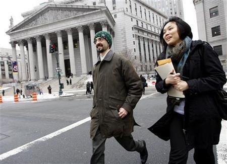 Sergey Aleynikov and his lawyer, Sabrina Shroff, depart from federal court in New York February 17, 2010. REUTERS/Chip East