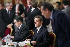 <p>France's Prime Minister Francois Fillon (L) and President Nicolas Sarkozy (C) attend a working lunch at the Elysee Palace in Paris March 19, 2011. At right is Iraq's Foreign Minister Hoshyar Zebari. World leaders gathered in Paris on Saturday to discuss a coordinated military intervention in Libya, where Muammar Gaddafi defied the West with an advance into the rebel stronghold of Benghazi. REUTERS/Pool (FRANCE - Tags: POLITICS)</p>