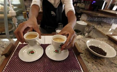 A waitress serves coffee to customers at a coffee bar in Sao Paulo February 8, 2011. REUTERS/Nacho Doce
