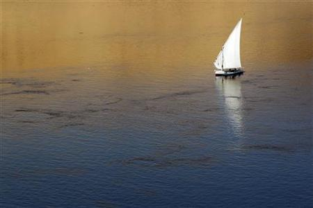A traditional Egyptian ''Felucca'' boat sails on the Nile river in the southern Egyptian city of Aswan about 879 km (549 miles) south of Cairo November 8, 2010. REUTERS/Amr Abdallah Dalsh