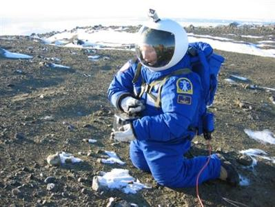 Argentine aerospace engineer Pablo de Leon, a NASA team member, collects samples as he tests a space suit designed for possible use in Mars at Argentina's Marambio base in Antarctica in this handout photo dated March 13, 2011. The NDX-1 space suit, designed by De Leon, endured frigid temperatures and winds of more than 47 mph (75 kph) as researchers tried out techniques for collecting soil samples on Mars.The $100,000 prototype suit, created with NASA funds, is made out of more than 350 materials, including tough honeycomb Kevlar and carbon fibers to reduce its weight without losing resistance. REUTERS/Nasa/Handout