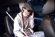 <p>Dallas Wiens talks on his cell phone while on his way to Brigham and Women's Hospital in Boston, Massachusetts in this undated handout photograph. Twenty five year-old Wiens from Texas has received the first full face transplant done in the United States, Boston's Brigham and Women's Hospital said on March 21, 2011. More than 30 physicians, nurses, anesthesiologists and residents worked for more than 15 hours to replace the nose, lips, facial skin, muscles of facial animation and nerves of Dallas Wiens, disfigured in an electrical accident in 2008. REUTERS/Lightchaser Photography/Handout</p>
