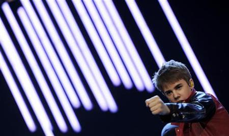 Canadian singer Justin Bieber performs on stage during the German TV game show ''Wetten Dass...?'' (Bet it...?) in Augsburg, southern Germany, on March 19, 2011. REUTERS/Christof Stache/Pool