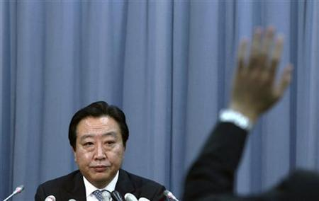 A reporter raises his hand to pose a question to Japanese Finance Minister Yoshihiko Noda at a news conference in Tokyo in this December 24, 2010 file photo. REUTERS/Kim Kyung-Hoon