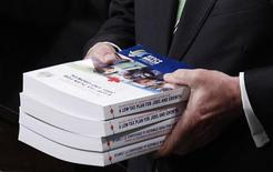 <p>Canada's Finance Minister Jim Flaherty holds copies of his budget in the House of Commons on Parliament Hill in Ottawa March 22, 2011. REUTERS/Chris Wattie</p>