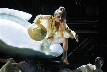 Lady Gaga steps out of a translucent egg to perform her new song ''Born This Way'' at the 53rd annual Grammy Awards in Los Angeles, California February 13, 2011. REUTERS/Lucy Nicholson
