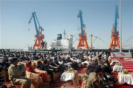 Participants listen to a speech by Pakistan's President Pervez Musharraf during the opening of the Gwadar deep-sea port on the Arabian Sea in 2007. REUTERS/Stringer