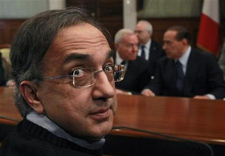 Fiat SpA and Chrysler LLC Chief Executive Officer Sergio Marchionne (L) looks back as he attends a meeting with Italy's Prime Minister Silvio Berlusconi (R) at the Chigi palace in Rome February 12, 2011. REUTERS/Alessandro Bianchi