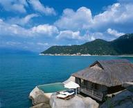 <p>1. Six Senses Ninh Van Bay, Nha Trang, Vietnam Set on a private peninsula that's just a sexy speedboat ride from coastal town Nha Trang in south-central Vietnam, romantic boutique hotel Six Senses Ninh Van Bay offers luxury for lovers. Its 58 dreamy villas all feature seductive beds and bath tubs open to the outdoors, with private pools for cooling dips (choose between beach, spa or waterside settings). You can also dine alfresco by the bay, the pool or up on the rocks for serene sea views - or book a table for two in the atmospherically lit Wine Cave, perfect for popping the question. After quality pampering at the Six Senses Spa, make a date with a sunlounger on the secluded beach. REUTERS/Handout</p>