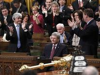 <p>Canadian Prime Minister Stephen Harper is applauded after voting on a non-confidence motion in the House of Commons on Parliament Hill in Ottawa, March 25, 2011. REUTERS/Chris Wattie</p>