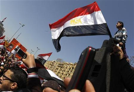 People wave Egyptian flags during a pro-democracy rally at Tahrir Square, in Cairo March 4, 2011. REUTERS/Peter Andrews
