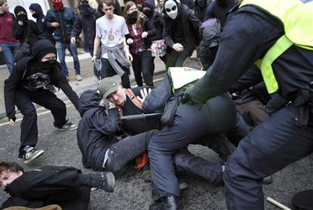 Police officers clash with demonstrators in Oxford Street, during a protest organised by the Trades Union Congress (TUC), called 'The March for the Alternative,' in central London March 26, 2011. REUTERS/Dylan Martinez