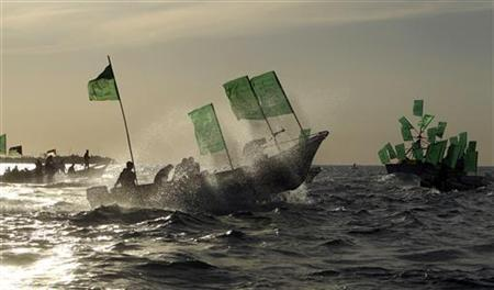 Palestinian Hamas supporters ride on boats with Hamas flags off the coast of Gaza City, December 9, 2010. REUTERS/Mohammed Salem
