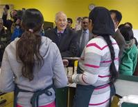 <p>NDP leader Jack Layton greets clerks while visiting a small grocery store in Surrey, British Columbia March 27, 2011. REUTERS/Andy Clark</p>