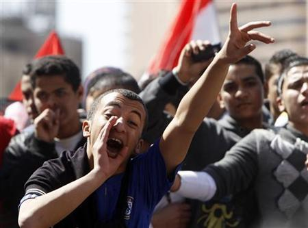 Students shout slogans as they demand the reopening of schools during a demonstration at Tahrir Square in Cairo February 27, 2011. REUTERS/Amr Abdallah Dalsh