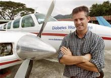 <p>Former Royal Air Force fighter pilot Douglas Cairns poses with his Beech Baron twin engine plane at Bangpra airfield, east of Bangkok, in this December 8, 2002 file photo. REUTERS/Sukree Sukplang</p>
