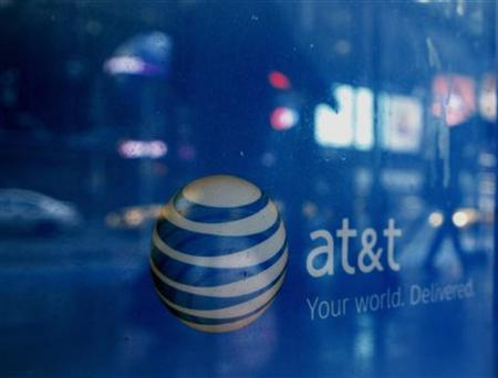 Reflections are seen in the window of an AT&T store in New York March 21, 2011. REUTERS/Brendan McDermid