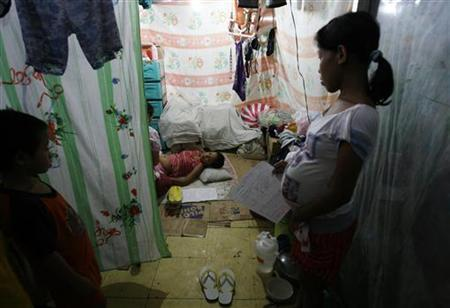 A pregnant woman waits for her turn to be examined by midwives from the United Nations Population Fund (UNFPA) at an evacuation centre in Laguna's San Pedro town, south of Manila November 4, 2009.