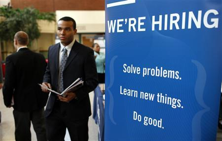 A job seeker walks the floor at a large career fare at Rutgers University in New Brunswick, New Jersey, in this January 6, 2011 file photo. REUTERS/Mike Segar