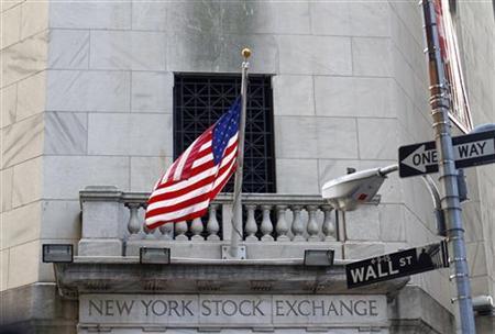 A U.S. flag hangs outside the New York Stock Exchange building, February 15, 2011. REUTERS/Joshua Lott