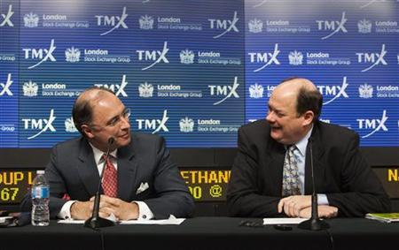 London Stock Exchange CEO Xavier Rolet (L) and TMX Group CEO Tom Kloet speak to the media regarding the merger of the TSX and the LSE in Toronto, February 9, 2011. REUTERS/Mark Blinch