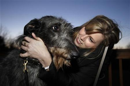 Angela Lloyd, who handled Hickory at this year's Westminster Dog Show is reunited with Hickory at a party in Bentonville, Virginia on March 12, 2011. REUTERS/Hyungwon Kang