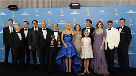 Matthew Weiner (C) and the cast of ''Mad Men'' pose backstage after winning outstanding drama series at the 62nd annual Primetime Emmy Awards in Los Angeles, California August 29, 2010. REUTERS/Danny Moloshok