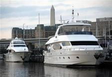 <p>Private motor yachts are docked at Gangplank Marina in Washington October 19, 2010. Indians are the most likely members of the global super rich to spend more on private jets and yachts over the next five years while Africans and Russians are expected to increase their charitable giving, a survey showed on Wednesday. REUTERS/Molly Riley</p>