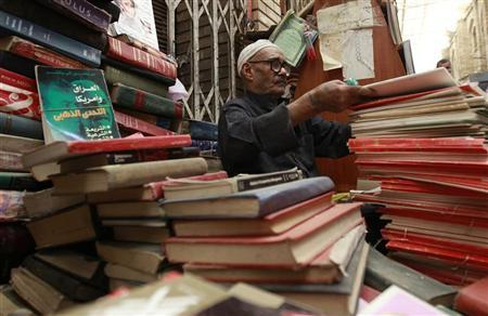 A vendor sells books at Mutanabi Street in Baghdad April 5, 2011. REUTERS/Mohammed Ameen