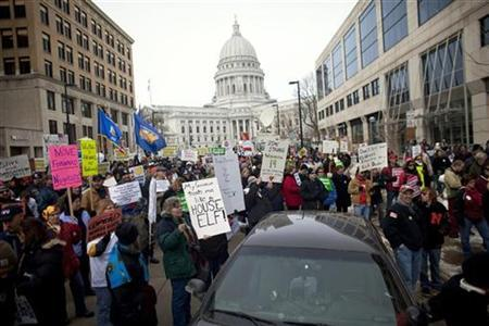 Demonstrators march around the State Capitol building as they protest against budget cuts from Wisconsin Governor Scott Walker, in Madison February 25, 2011. REUTERS/Darren Hauck