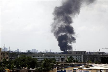 A plume of smoke rises over Abidjan, April 6, 2011. REUTERS/Emmanuel Braun