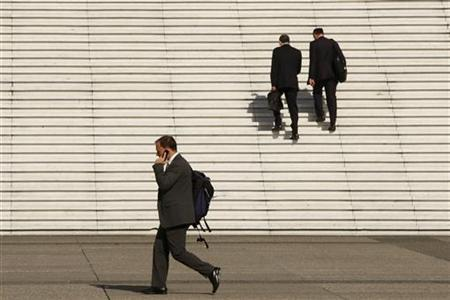 A businessman speaks on his phone near the steps at the Arche de la Defense, the financial and business district west of Paris, August 5, 2009. REUTERS/Benoit Tessier