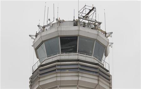 The main air traffic control tower at Reagan Washington National Airport is seen on March 24, 2011. REUTERS/Hyungwon Kang