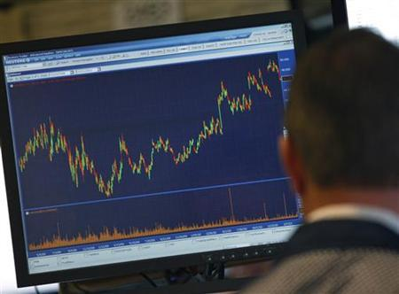 A trader works on the floor at the New York Stock Exchange, March 21, 2011. REUTERS/Brendan McDermid